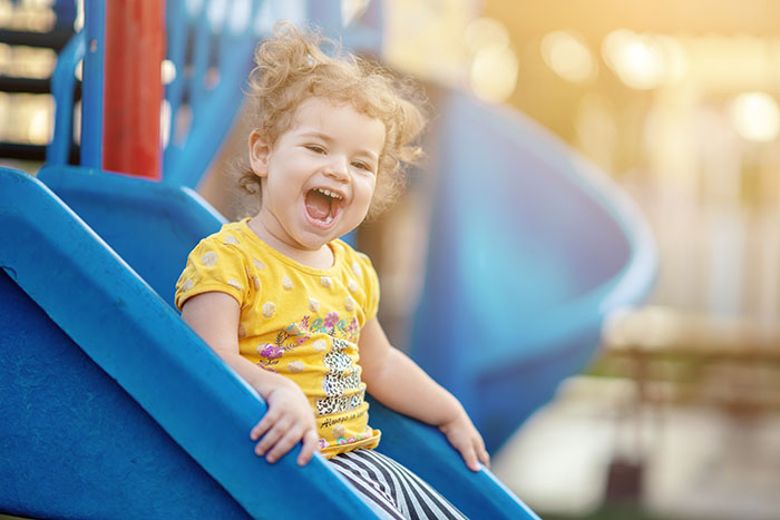 happy Toddler Playing At Playground at a Preschool & Daycare Serving North Hollywood, Santa Monica & Van Nuys, CA