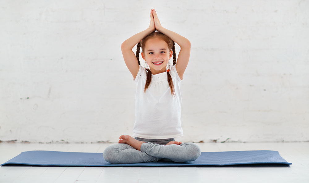 girl doing yoga at a Preschool & Daycare Serving North Hollywood, Santa Monica & Van Nuys, CA