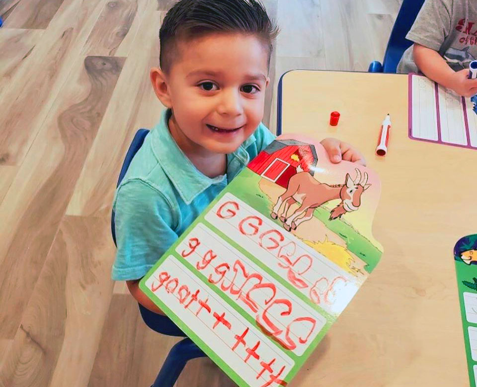happy boy learning letters at a Preschool & Daycare Serving North Hollywood & Santa Monica, CA