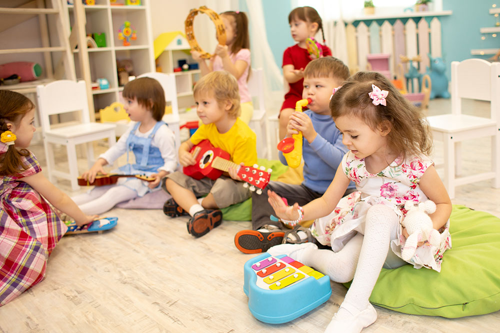 kindergarten children with musical instruments at a Preschool & Daycare Serving North Hollywood & Santa Monica, CA