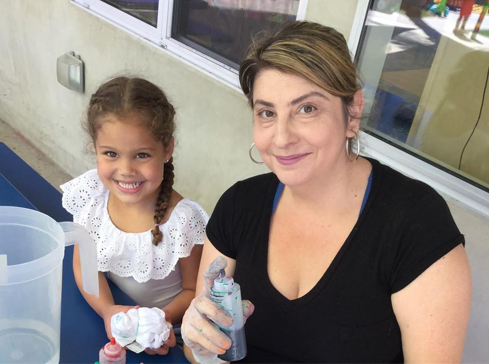 smiling girl with mom at a Preschool & Daycare Serving North Hollywood & Santa Monica, CA