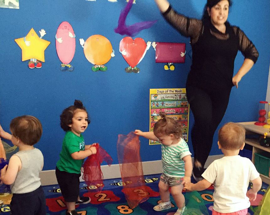teacher and toddlers at a Preschool & Daycare Serving North Hollywood, Santa Monica & Van Nuys, CA