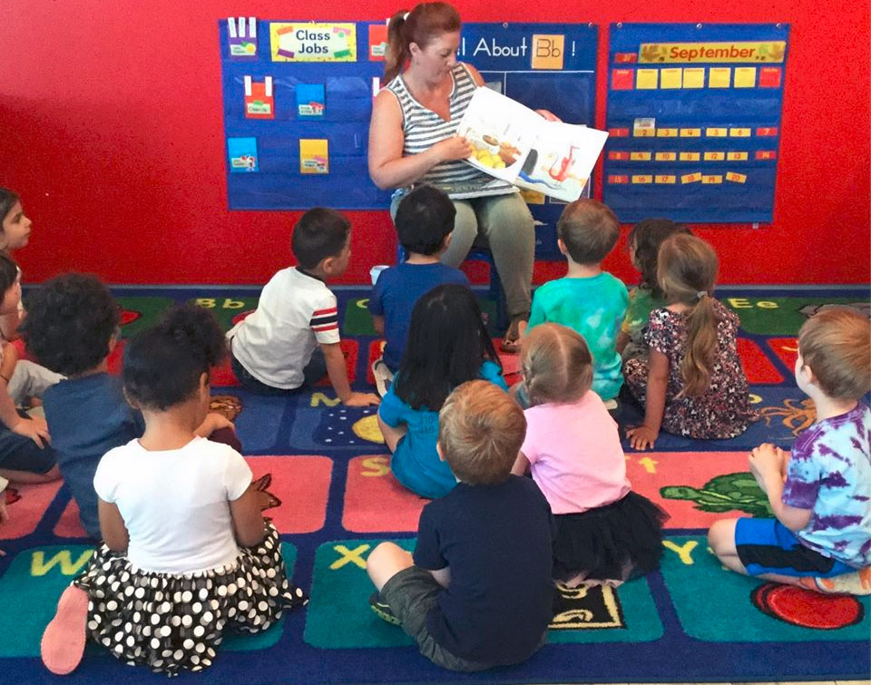 teacher reading to children at a Preschool & Daycare Serving North Hollywood & Santa Monica, CA