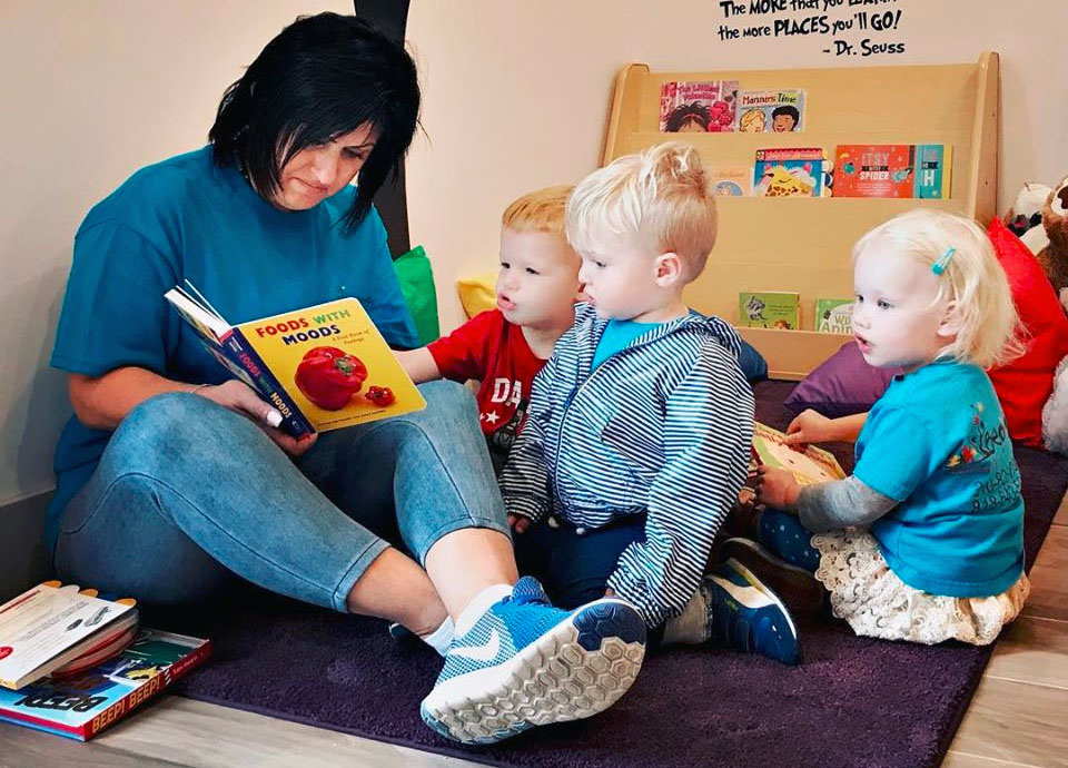 teacher reading to toddlers at a Preschool & Daycare Serving North Hollywood & Santa Monica, CA